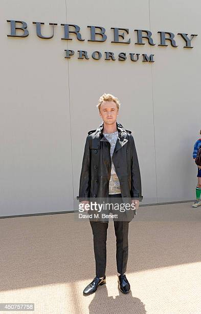 Tom Felton arrives at Burberry Prorsum SS15 during London Collections Men at Kensington Gardens on June 17 2014 in London England