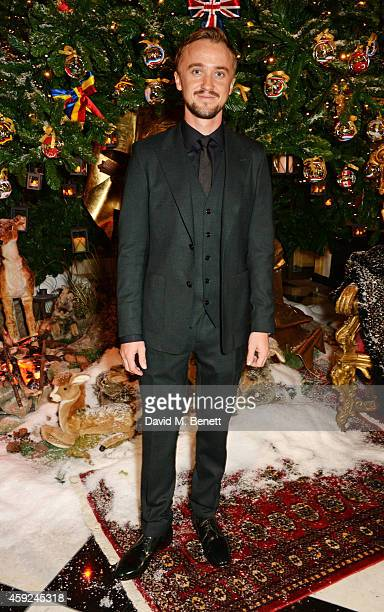 Tom Felton attends the Claridge's Dolce and Gabbana Christmas Tree party at Claridge's Hotel on November 19 2014 in London England