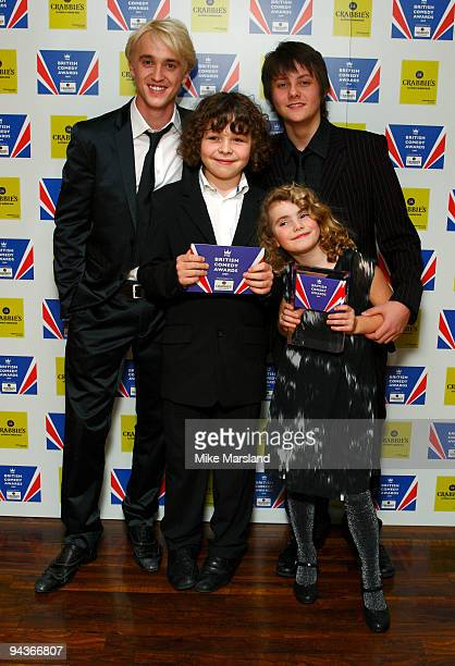 Tom Felton Ramona Marquez Daniel Roche and Tyger DrewHoney poses in the press room at the British Comedy Awards on December 12 2009 in London England