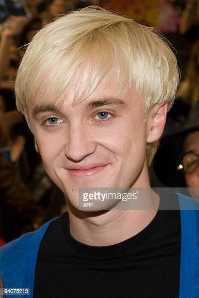 Tom Felton who played 'Draco Malfoy' in the Harry Potter film series poses at a promotional event at the HMV store on Oxford Street in central London...