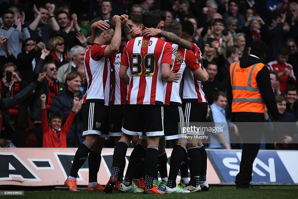 Tom Field celebrates with his Brentford team mates during the Sky Bet Championship match between Brentford and Fulham at Griffin Park on April 30, 2016 in Brentford, United Kingdom.