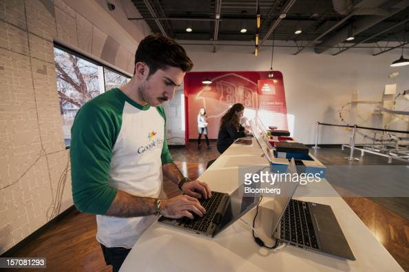 Tom Fitzgerald a Google Inc Fiber Space team member looks up an installation schedule for a customer in the showroom of the Fiber Space office in...
