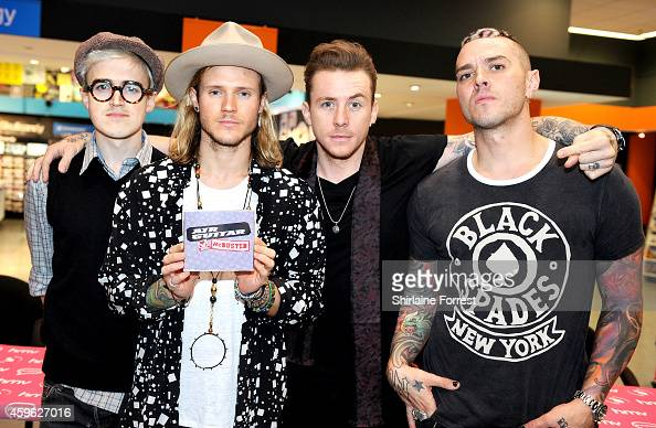 Tom Fletcher Dougie Poynter Danny Jones and Matt Willis of McBusted meet fans and sign copies of their album 'McBusted' at HMV on November 26 2014 in...