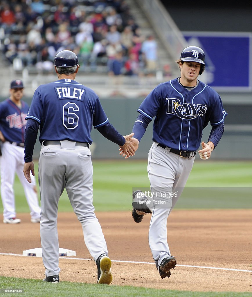 Tom Foley #6 of the Tampa Bay Rays congratulates <a gi-track='captionPersonalityLinkClicked' href=/galleries/search?phrase=Wil+Myers&family=editorial&specificpeople=7562808 ng-click='$event.stopPropagation()'>Wil Myers</a> #9 as Myers rounds the bases after hitting a two run home run against the Minnesota Twins during the fourth inning of the game on September 15, 2013 at Target Field in Minneapolis, Minnesota.