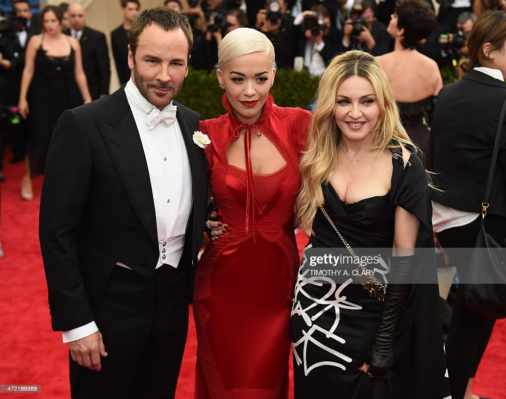 Tom Ford Rita Ora and Madonna arrive at the 2015 Metropolitan Museum of Art's Costume Institute Gala benefit in honor of the museums latest exhibit...