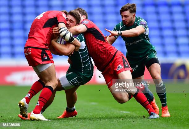 Tom Fowlie of London Irish is tackled by Dougie Fife and Chris Dean of Edinburgh during the European Rugby Challenge Cup match between London Irish...
