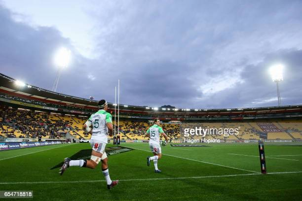 Tom Franklin and Ben Smith of the Highlanders take the field during the round four Super Rugby match between the Hurricanes and the Highlanders at...