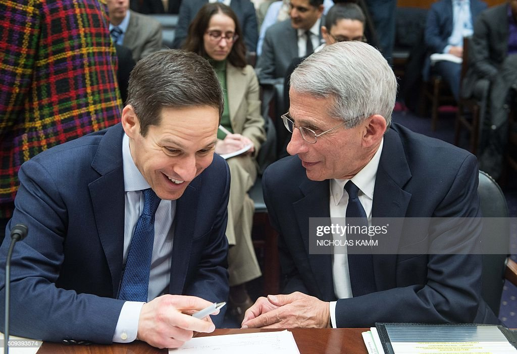Tom Frieden (L), director of the Centers for Disease Control and Prevention and Anthony Fauci, director of the National Institute of Allergy and Infectious Diseases, chat before an Africa, Global Health, Global Human Rights and International Organizations Subcommittee and Western Hemisphere Subcommittee hearing on 'The Global Zika Epidemic: Emerging in the Americas' on Capitol Hill in Washington, DC, on February 10, 2016. / AFP / NICHOLAS KAMM
