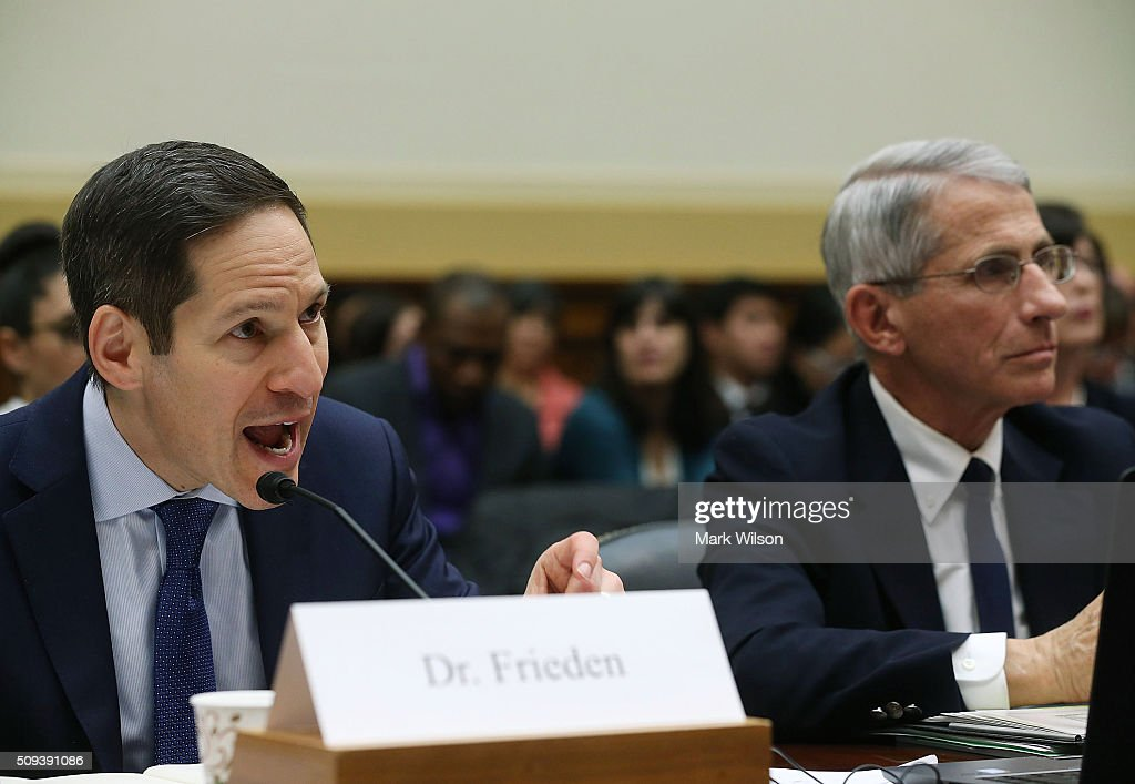 <a gi-track='captionPersonalityLinkClicked' href=/galleries/search?phrase=Tom+Frieden&family=editorial&specificpeople=11365236 ng-click='$event.stopPropagation()'>Tom Frieden</a> (L), director of the Centers for Disease Control and Prevention, testifies while flanked by <a gi-track='captionPersonalityLinkClicked' href=/galleries/search?phrase=Anthony+Fauci&family=editorial&specificpeople=964622 ng-click='$event.stopPropagation()'>Anthony Fauci</a>, director of the National Institute of Allergy and Infectious Diseases, during a House Foreign Affairs Committee hearing on Capitol Hill, February 10, 2016 in Washington, DC. The committee heard testimony from health officials on the Zika virus epidemic, and its threat to the Americas.