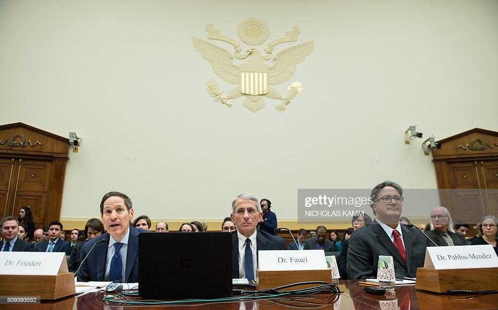 Tom Frieden (L), director of the Centers for Disease Control and Prevention testifies with Anthony Fauci (C), director of the National Institute of Allergy and Infectious Diseases, and Ariel Pablos-Mendez, assistant administrator of the U.S. Agency for International Development's Bureau for Global Health, at an Africa, Global Health, Global Human Rights and International Organizations Subcommittee and Western Hemisphere Subcommittee hearing on 'The Global Zika Epidemic: Emerging in the Americas' on Capitol Hill in Washington, DC, on February 10, 2016. / AFP / NICHOLAS KAMM