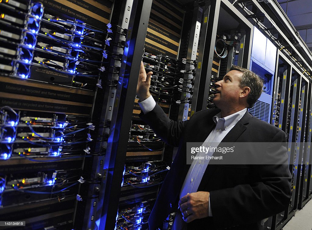 Tom Furlong, Vice President of Site Operations at Facebook, points out servers during a tour of the new Facebook Data Center on April 19, 2012 in Forest City, North Carolina. The company began construction on the facility in November 2010 and went live today, serving the 845 million Facebook users worldwide.
