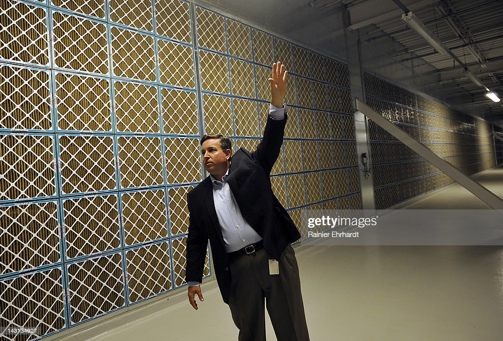 Tom Furlong, Vice President of Site Operations at Facebook, points to air inlets and filters during a tour of the new Facebook Data Center on April 19, 2012 in Forest City, North Carolina. The company began construction on the facility in November 2010 and went live today, serving the 845 million Facebook users worldwide.