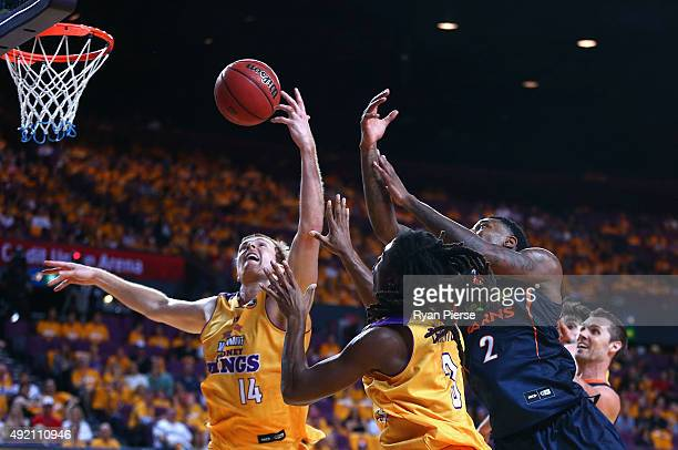 Tom Garlepp and Marcus Thornton of the Kings compete for the ball against Torrey Craig of the Taipans during the round one NBL match between the...