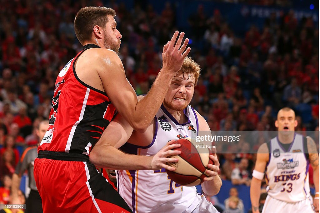 Tom Garlepp of the Kings drives to the basket against Tom Jervis of the Wildcats during the round two NBL match between the Perth Wildcats and the Sydney Kings at Perth Arena in October 18, 2013 in Perth, Australia.