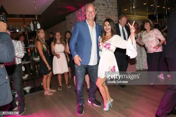 Tom Gerhardt and his wife Nadja da Silva dance during the wedding of Torsten Koch and Annika Hofmann at Hotel Wiesergut on July 22 2017 in...