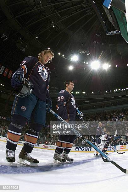 Tom Gilbert and Sam Gagner of the Edmonton Oilers stand for the anthem before a preseason game against the Florida Panthers on September 25 2008 at...