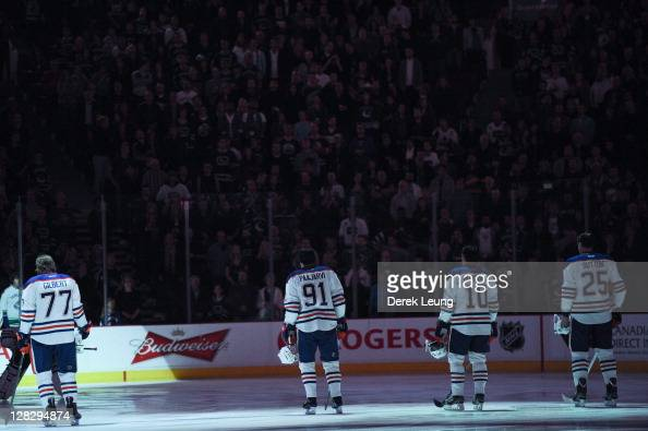 Tom Gilbert Magnus Paajarvi Shawn Horcoff Andy Sutton of the Edmonton Oilers during the singing of the national anthem in a game against the...