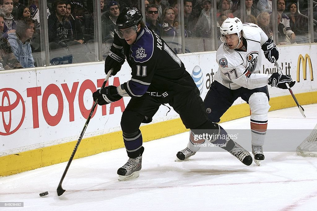 Tom Gilbert of the Edmonton Oilers chases Anze Kopitar of the Los Angeles Kings behind the net during the game on February 14 2009 at Staples Center...