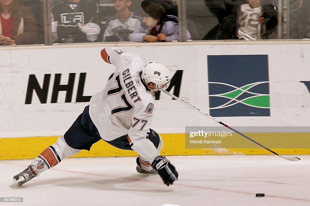 Tom Gilbert of the Edmonton Oilers loses his balance during a game against the Los Angeles Kings on February 14 2009 at Staples Center in Los Angeles...