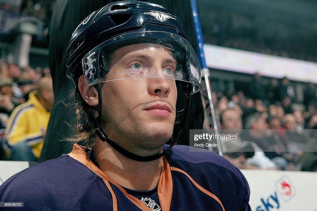 Tom Gilbert of the Edmonton Oilers sits on the bench during a game against the Phoenix Coyotes on March 18 2008 in Edmonton Alberta Canada