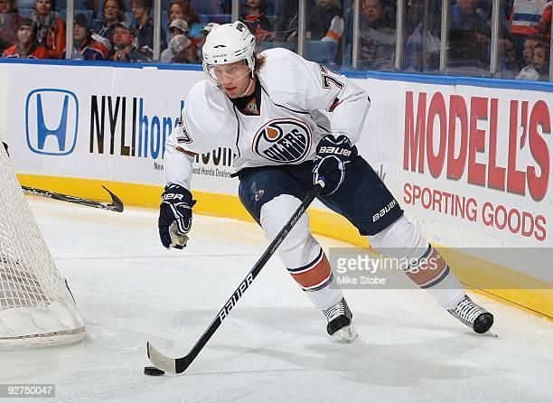 Tom Gilbert of the Edmonton Oilers skates against the New York Islanders on November 2 2009 at Nassau Coliseum in Uniondale New York Islanders defeat...