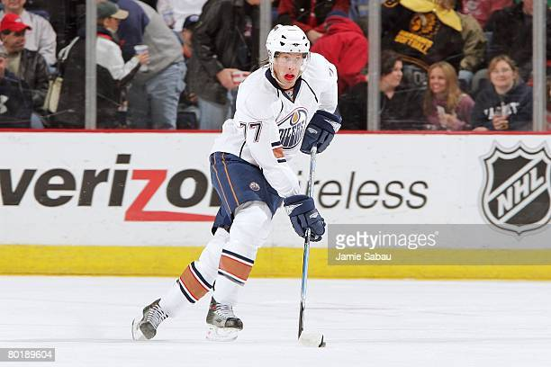 Tom Gilbert of the Edmonton Oilers skates with the puck against the Columbus Blue Jackets on March 7 2008 at Nationwide Arena in Columbus Ohio