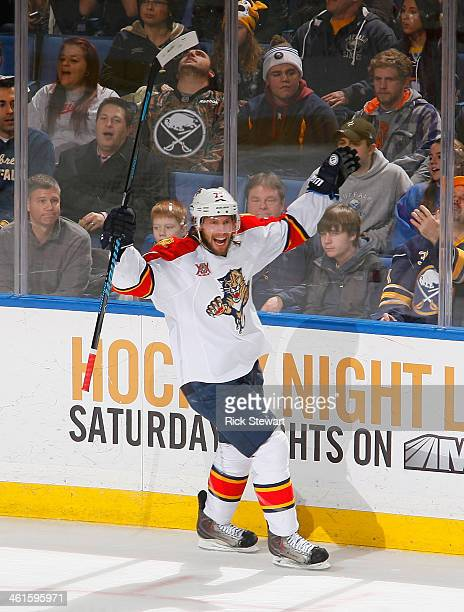 Tom Gilbert of the Florida Panthers celebrates after scoring Florida's first goal of the game against the Buffalo Sabres at First Niagara Center on...