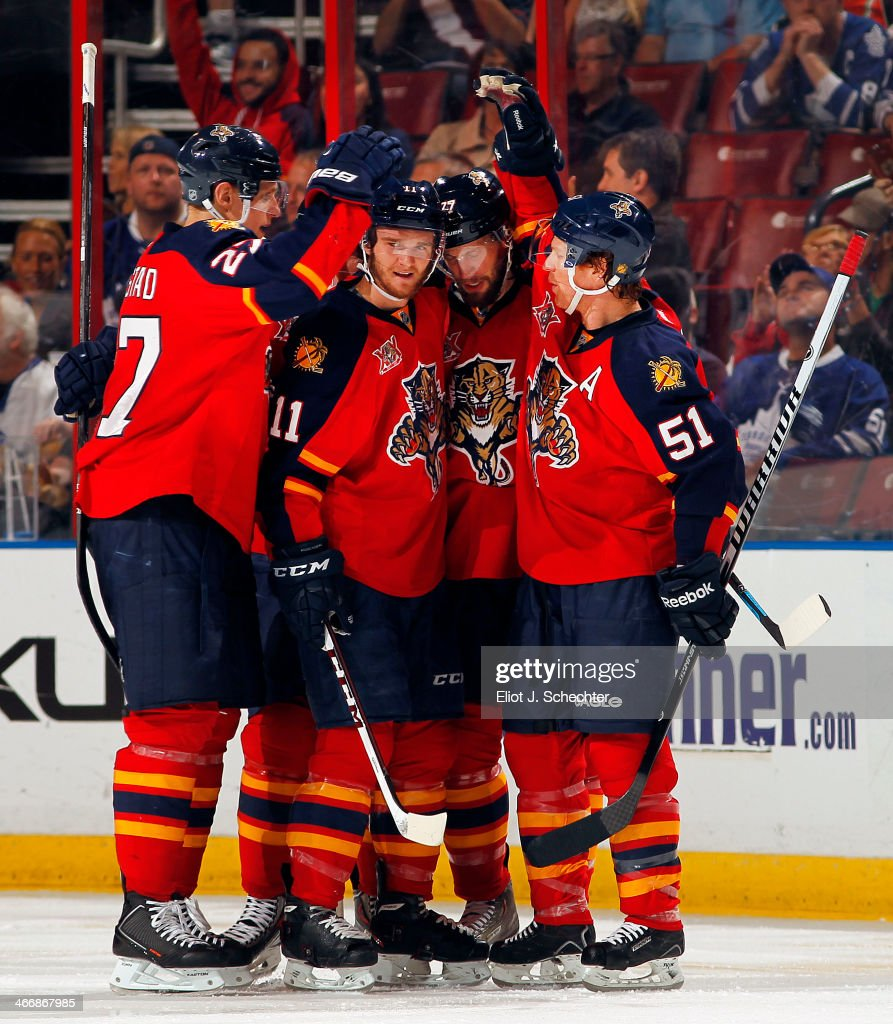Tom Gilbert #77 of the Florida Panthers celebrates his goal with teammates against the Toronto Maple Leafs at the BB&T Center on February 4, 2014 in Sunrise, Florida.