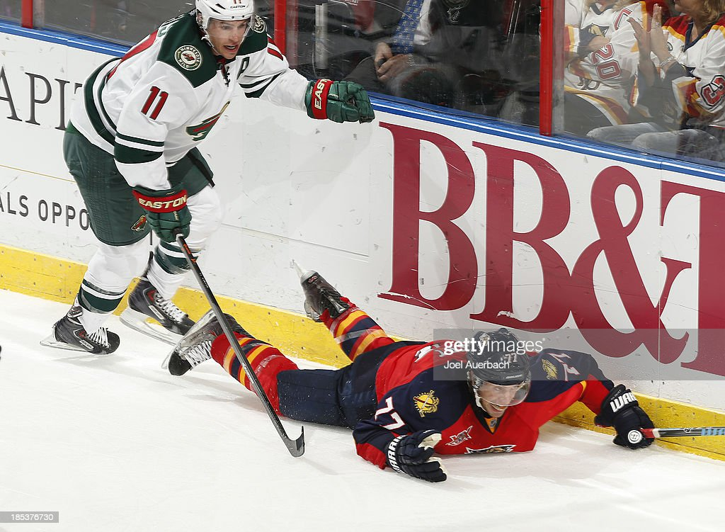 <a gi-track='captionPersonalityLinkClicked' href=/galleries/search?phrase=Tom+Gilbert&family=editorial&specificpeople=687083 ng-click='$event.stopPropagation()'>Tom Gilbert</a> #77 of the Florida Panthers is taken to the ice by <a gi-track='captionPersonalityLinkClicked' href=/galleries/search?phrase=Zach+Parise&family=editorial&specificpeople=213606 ng-click='$event.stopPropagation()'>Zach Parise</a> #11 of the Minnesota Wild at the BB&T Center on October 19, 2013 in Sunrise, Florida. The Panthers defeated the Wild 2-1 in a shoot-out.