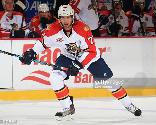 Tom Gilbert of the Florida Panthers skates up ice against the Detroit Red Wings during an NHL game at Joe Louis Arena on December 7 2013 in Detroit...