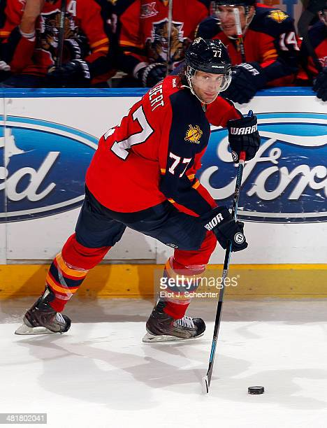 Tom Gilbert of the Florida Panthers skates with the puck against the Ottawa Senators at the BBT Center on March 25 2014 in Sunrise Florida