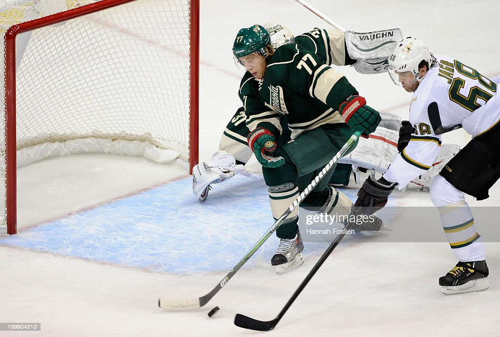 <a gi-track='captionPersonalityLinkClicked' href=/galleries/search?phrase=Tom+Gilbert&family=editorial&specificpeople=687083 ng-click='$event.stopPropagation()'>Tom Gilbert</a> #77 of the Minnesota Wild blocks a shot by Jaromir Jagr #68 of the Dallas Stars during the first period of the game on January 20, 2013 at Xcel Energy Center in St Paul, Minnesota. The Wild defeated the Stars 1-0.