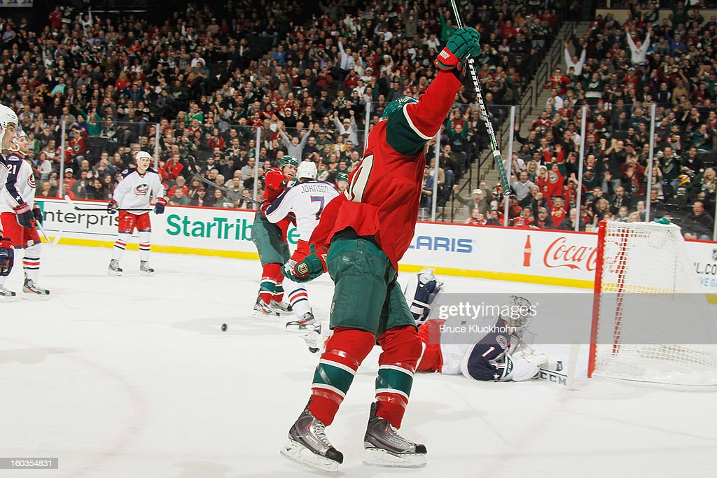 <a gi-track='captionPersonalityLinkClicked' href=/galleries/search?phrase=Tom+Gilbert&family=editorial&specificpeople=687083 ng-click='$event.stopPropagation()'>Tom Gilbert</a> #77 of the Minnesota Wild celebrates after scoring a goal against the Columbus Blue Jackets during the game on January 29, 2013 at the Xcel Energy Center in Saint Paul, Minnesota.