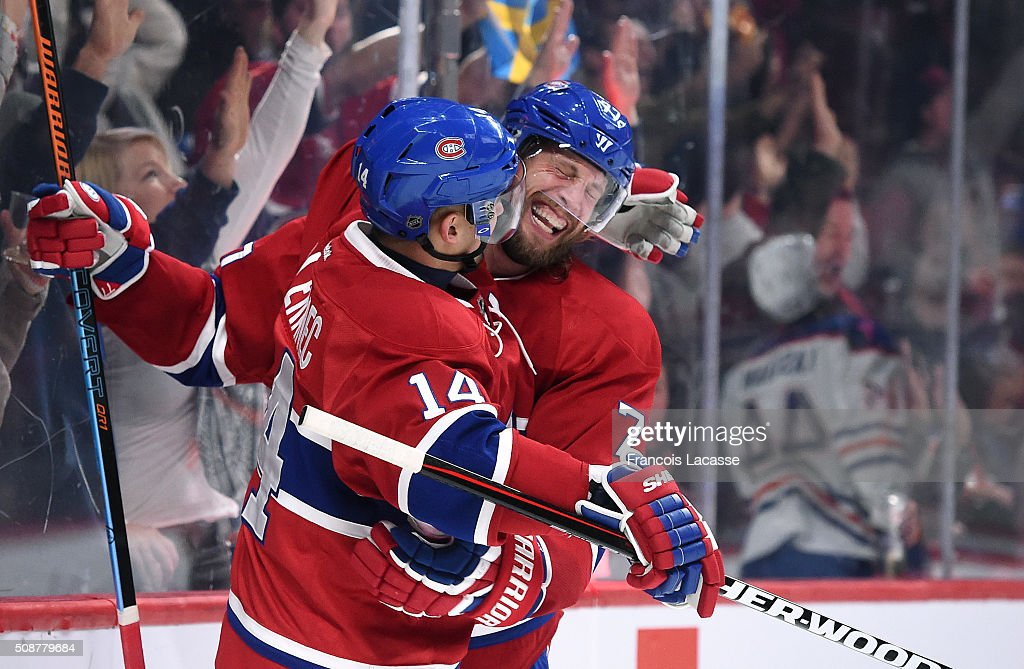 <a gi-track='captionPersonalityLinkClicked' href=/galleries/search?phrase=Tom+Gilbert&family=editorial&specificpeople=687083 ng-click='$event.stopPropagation()'>Tom Gilbert</a> #77 of the Montreal Canadiens celebrates after scoring a goal against the Edmonton Oilers in the NHL game at the Bell Centre on February 6, 2016 in Montreal, Quebec, Canada.
