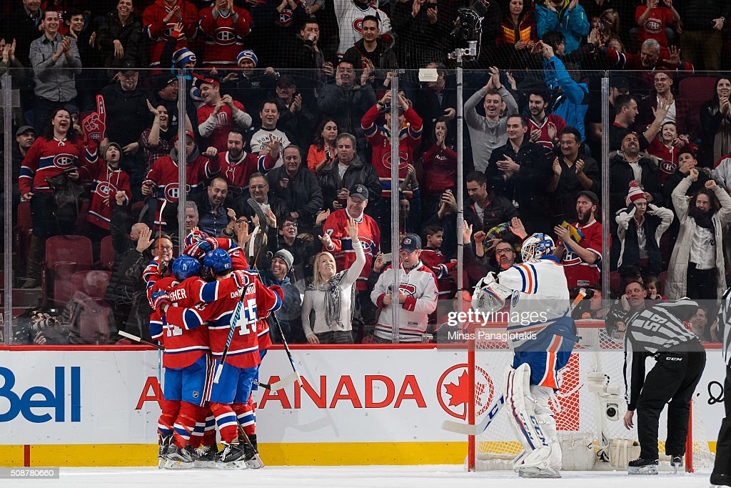 Tom Gilbert of the Montreal Canadiens celebrates his goal with teammates during the NHL game against the Edmonton Oilers at the Bell Centre on...