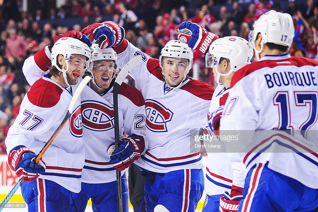 Tom Gilbert of the Montreal Canadiens celebrates with his teammates after scoring against the Calgary Flames during an NHL game at Scotiabank...