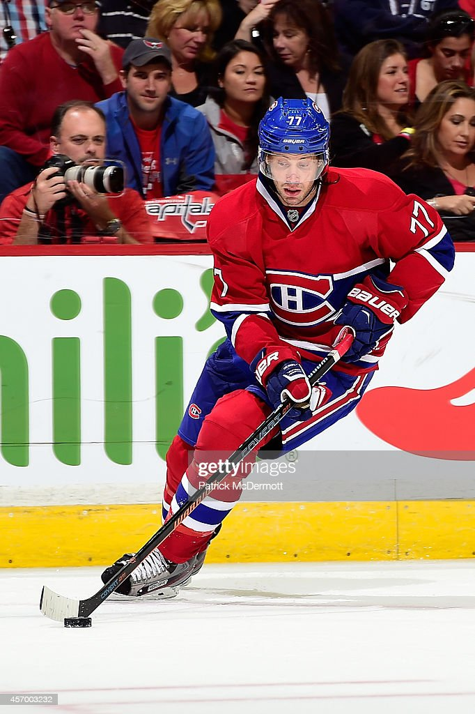Tom Gilbert of the Montreal Canadiens controls the puck in the second period of game against the Washington Capitals in the Capitals season opener at...