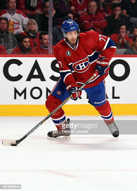 Tom Gilbert of the Montreal Canadiens looks to pass the puck against the San Jose Sharks in the NHL game at the Bell Centre on March 21 2015 in...