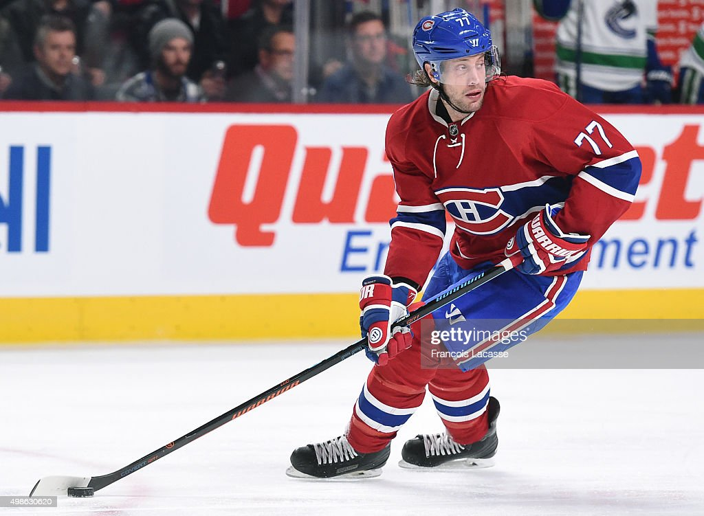 Tom Gilbert of the Montreal Canadiens looks to pass the puck against the Vancouver Canucks in the NHL game at the Bell Centre on November 16 2015 in...