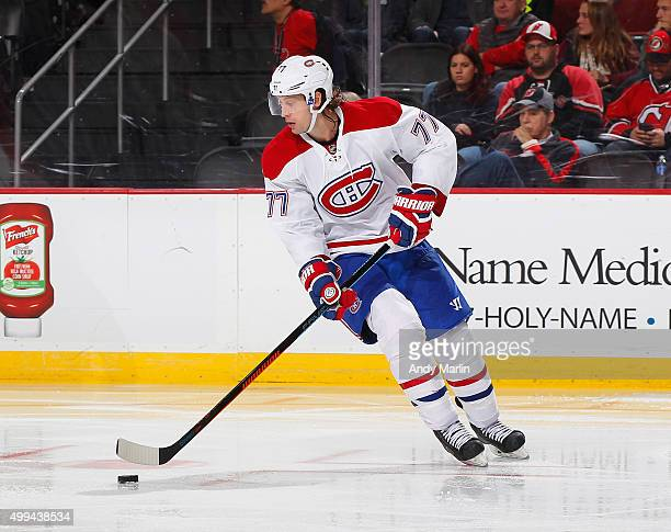 Tom Gilbert of the Montreal Canadiens plays the puck during the game against the New Jersey Devils at the Prudential Center on November 27 2015 in...