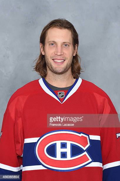 Tom Gilbert of the Montreal Canadiens poses for his official headshot for the 20142015 season on September 18 2014 at the Bell Sports Complex in...