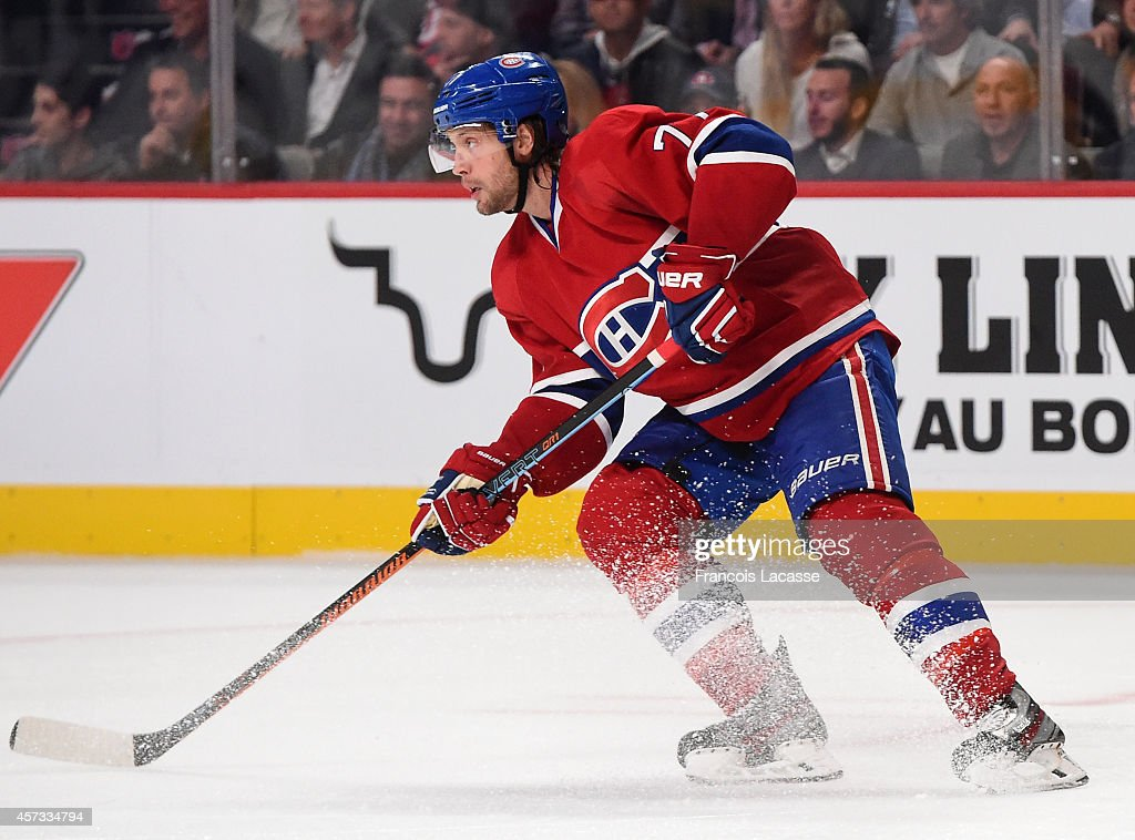 Tom Gilbert of the Montreal Canadiens skates on the ice against the Boston Bruins in the NHL game at the Bell Centre on October 16 2014 in Montreal...