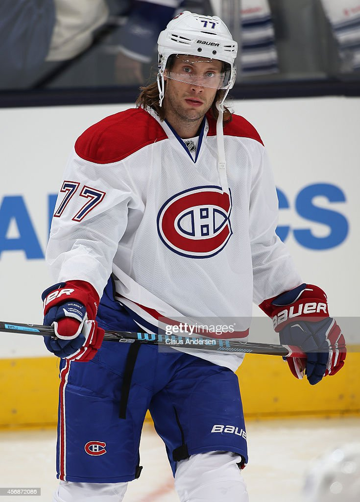 Tom Gilbert of the Montreal Canadiens skates prior to playing against the Toronto Maple Leafs in their NHL season opener at the Air Canada Centre on...