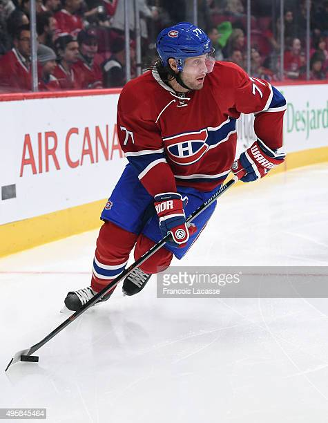 Tom Gilbert of the Montreal Canadiens skates with the puck against the Winnipeg Jets in the NHL game at the Bell Centre on November 1 2015 in...
