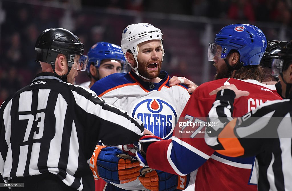 <a gi-track='captionPersonalityLinkClicked' href=/galleries/search?phrase=Tom+Gilbert&family=editorial&specificpeople=687083 ng-click='$event.stopPropagation()'>Tom Gilbert</a> #77 of the Montreal Canadiens speks with <a gi-track='captionPersonalityLinkClicked' href=/galleries/search?phrase=Zack+Kassian&family=editorial&specificpeople=4604939 ng-click='$event.stopPropagation()'>Zack Kassian</a> #44 of the Edmonton Oilers in the NHL game at the Bell Centre on February 6, 2016 in Montreal, Quebec, Canada.