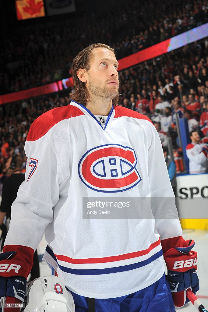 Tom Gilbert of the Montreal Canadiens stands for the singing of the national anthem prior to a game against the Edmonton Oilers on October 27 2014 at...