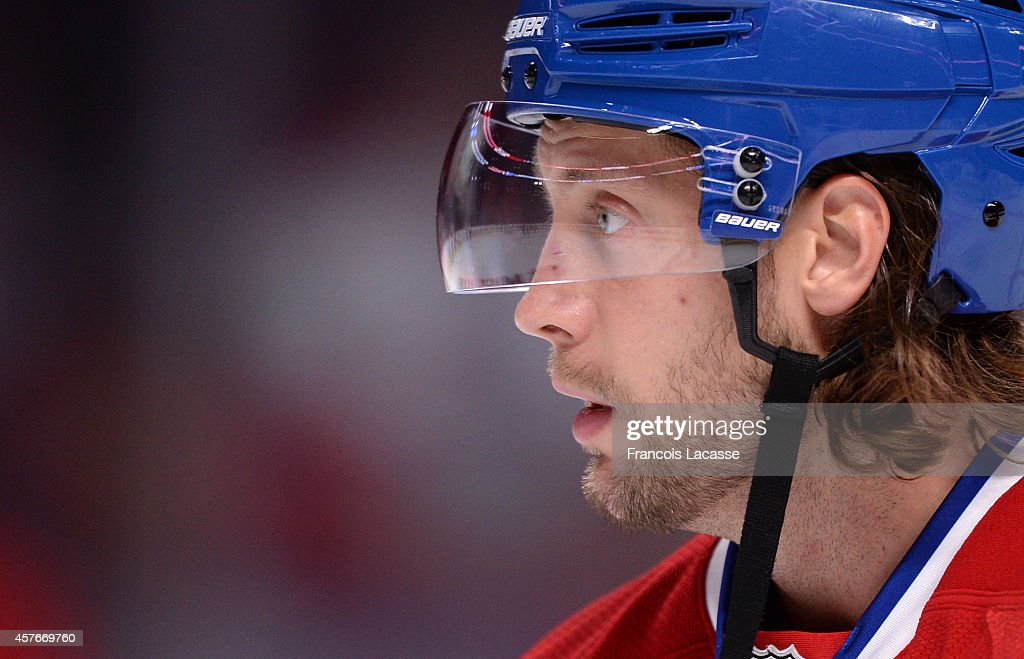 Tom Gilbert of the Montreal Canadiens warms up prior to the game against the Boston Bruins in the NHL game at the Bell Centre on October 16 2014 in...