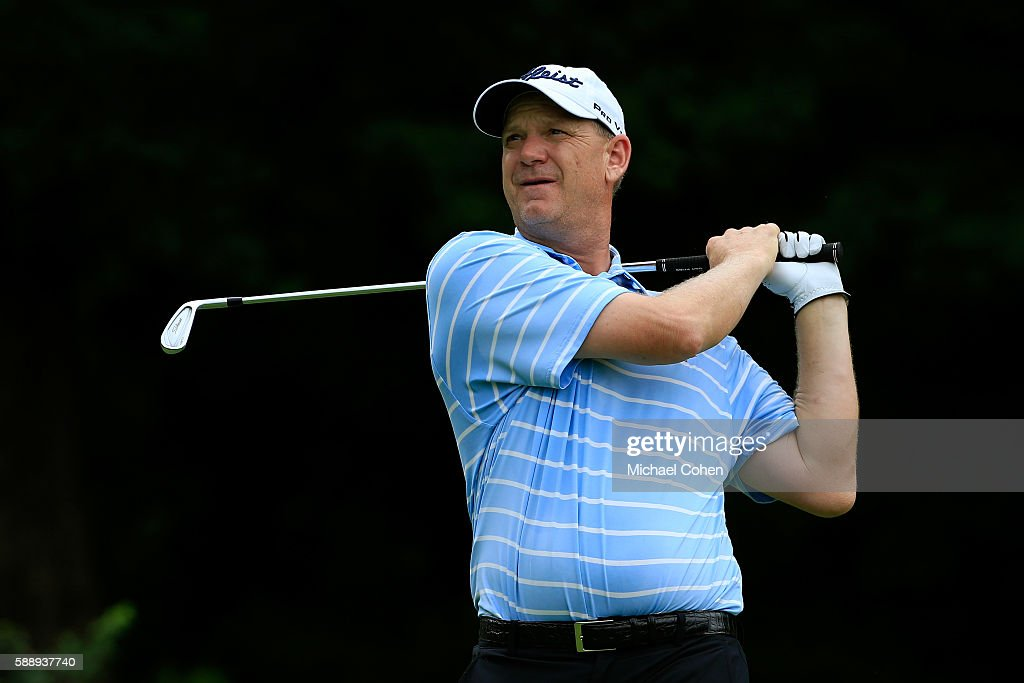 Tom Gillis plays his shot from the 12th tee during the second round of the John Deere Classic at TPC Deere Run on August 12 2016 in Silvis Illinois
