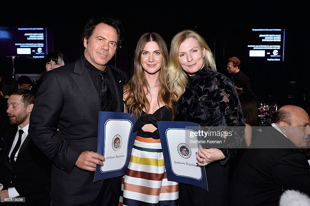 Tom Gores, Rochelle Gores Fredston and Holly Gores attend PSLA partners with Carolina Herrera for Winter Gala on January 26, 2017 in Beverly Hills, California.