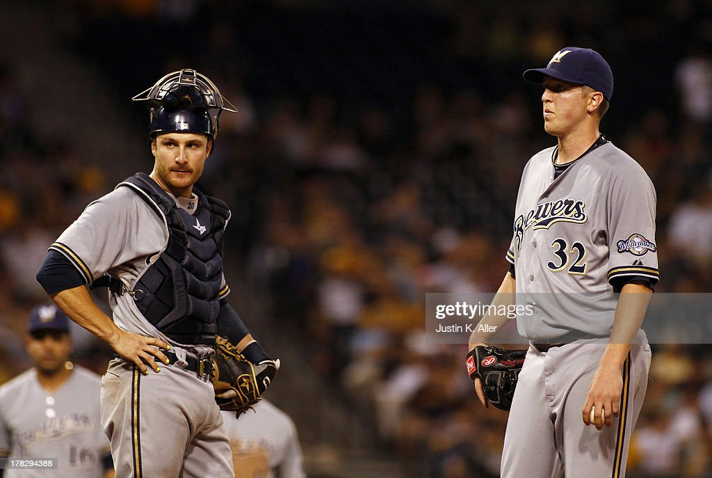 <a gi-track='captionPersonalityLinkClicked' href=/galleries/search?phrase=Tom+Gorzelanny&family=editorial&specificpeople=748773 ng-click='$event.stopPropagation()'>Tom Gorzelanny</a> #32 of the Milwaukee Brewers and <a gi-track='captionPersonalityLinkClicked' href=/galleries/search?phrase=Jonathan+Lucroy&family=editorial&specificpeople=5732413 ng-click='$event.stopPropagation()'>Jonathan Lucroy</a> #20 of the Milwaukee Brewers looks on during the game in the sixth inning against the Pittsburgh Pirates on August 28, 2013 at PNC Park in Pittsburgh, Pennsylvania.